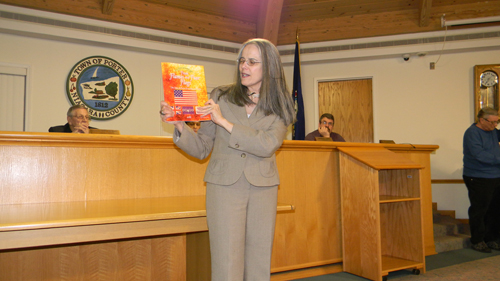 Presentations at Monday's meeting included the Town of Porter `Families 2012` quilt crafted as part of last year's bicentennial celebrations, and Town Historian Sue Dietz discussing her latest work, `From Flames and Four Flags - The Town of Porter Yesterday and Today.`  The book is now on sale at Town Hall, where the quilt is also on display. (photos by Terry Duffy)