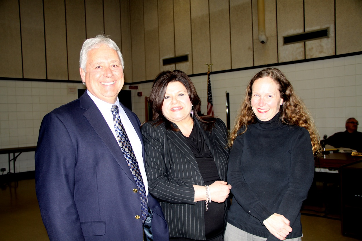 Lewiston-Porter Superintendent Christopher Roser (left) and Board President Jodee Riordan (right) congratulate counselor Daria Marinucci as part of National School Counseling Week.