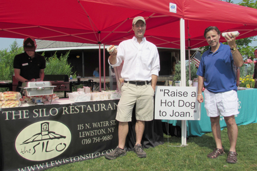 The Silo Restaurant owner Alan Hastings and Joseph Pillittere Jr. `Raise a Hot Dog to Joan.` (photos by Joshua Maloni)