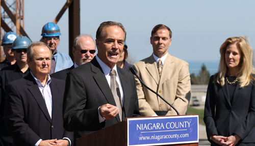 U.S. Rep. Chris Collins calls for actions protecting workers at the Somerset power plant operated by Upstate New York Power Producers Inc., as, from left, Sen. George D. Maziarz, IBEW Local 966 President Mike Lutz, Barker Central School District Superintendent Dr. Roger Klatt, and Assemblywoman Jane L. Corwin look on.