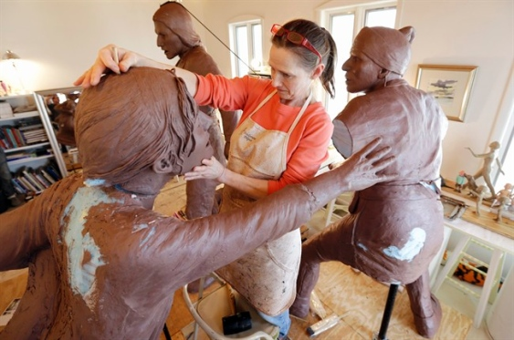 Sculptor Susan Geissler is shown working on the Tuscarora Heroes monument.