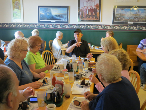 Tom George sits with diners at The Villa Coffee House.
