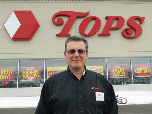 Anthony DiMino stands in front of the Village of Lewiston's Tops supermarket.