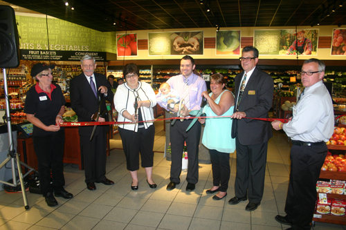 Tops Friendly Markets held a grand re-opening celebration to mark the completion of a major renovation of family-owned and operated Lewiston Tops Market at 906 Center St. Pictured from left: Lewiston Tops Markets Prepared Foods Manager Linda Hurtgam, Village of Lewiston Mayor Terry Collesano, Ann Marie Hepfer, John and A.J. DiMino (Anthony DiMino's son and grandson), Mary Rose Casero, Lewiston Tops Market owner DiMino and Lewiston Tops Markets Assistant Store Manager Tom Casero.