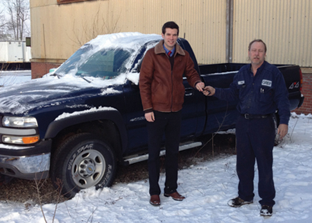 Niagara Hospice Alliance Director of Development Brendan McIntyre (left) receives keys to a donated Chevy pickup truck from Greif Plant electrician Don Heim (right).