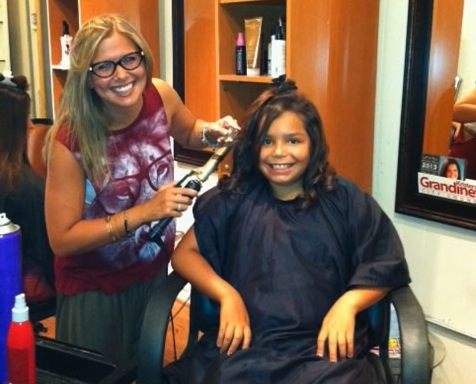 Sixth-grader Isabella Jacobs gets a new style from hairdresser Caitlin Carr at Mode Image.