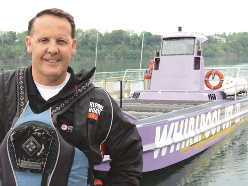 Whirlpool Jet Boat Tours President John Kinney stands next to one of his vessels. WJBT is located next to Water Street Landing at 115 S. Water St., Lewiston.