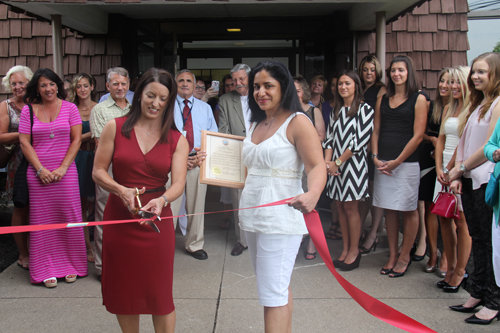 Pictured, Dr. Renee Taefi Baughman and Dr. Donna Azam Feldman with their staff and grand opening attendees.