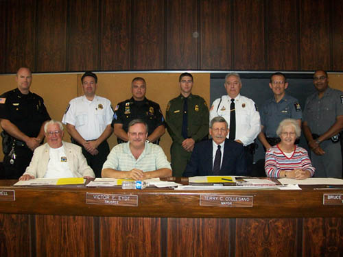 Pictured (top row, from left): LPD Police Chief Salada and officers James Suitor (Town of Niagara), LPD Sgt. Frank Previte, Adam Matuszewski (Border Patrol), Robert Shepherd (County Auxiliary), David A. Page (State Police) and Craig Hanesworth (State Police). Shown below them are trustees Ernie Krell, Vic Eydt, Collesano and Theresa Mudd.
