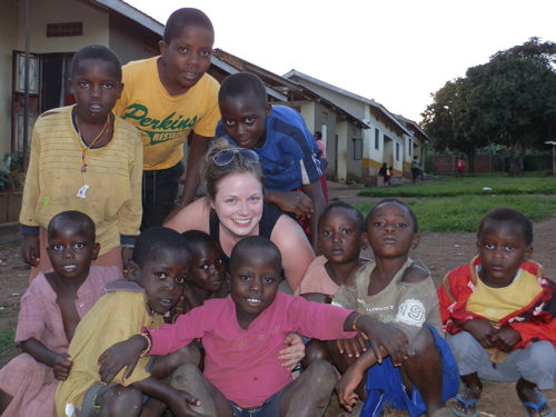 Alyssa Miller is pictured with some of the children she assisted while in Uganda. The Niagara University student spent her Christmas break serving those in need.