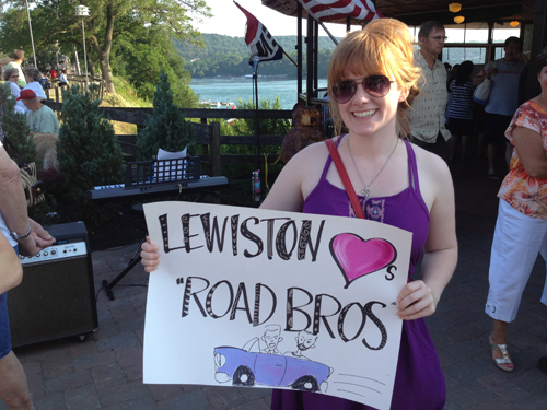 Kelly Hessinger proudly displays her sign welcoming the `Road Bros` to Lewiston. (photo by Joshua Maloni)