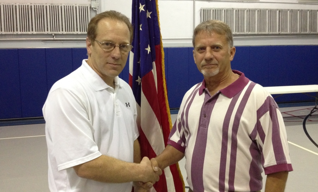Nick Conde (left) and Dennis Brochey shake hands after winning their election on Tuesday.