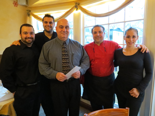 Angelo Grande, center, stands with Casa Antica's Jack Soldano and some of the Casa Antica staff. Grande won NFP's `Like Us on Facebook` contest and earned a $50 gift certificate to the family restaurant.