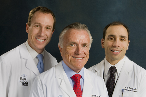 Pictured, from left, are doctors Thomas R. Elmer Jr., Claus M. Fichte and Michael J. Endl of Fichte, Endl & Elmer Eyecare. At left, Elmer performs LASIK surgery on a patient.
