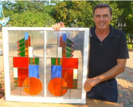 Artist Gene Kulbago with his stained glass `Frameworks` piece.