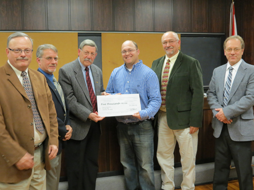 Village of Lewiston trustees Vic Eydt, Dennis Brochey, Bruce Sutherland and Nick Conde joined Mayor Terry Collesano (center, left) in presenting Town of Lewiston Recreation Department Director Mike Dashineau (in blue) with a check for $5,000 on Monday. The money will go toward the Academy Park ice rink, which opens Saturday, Dec. 1.
