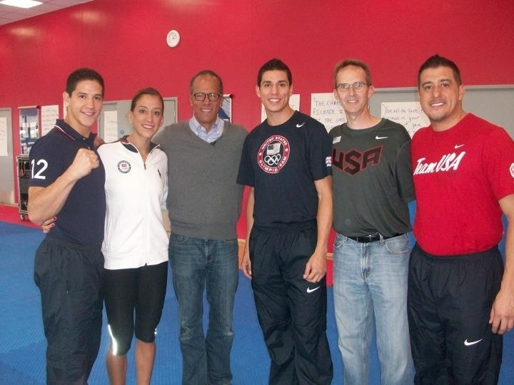 Pictured from the USA Taekwondo Team is the Lopez family alongside Bill Kellick (second from right) and `Today` weekend host Lester Holt (third from left) at the London Olympic Games.