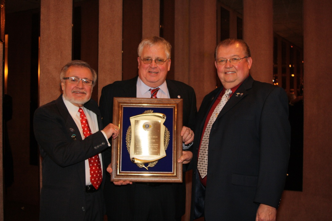 Dr. Jerry Mosey, left, Kiwanis president, poses with Kiwanian of the Year John Coulter and Bill Bennion.