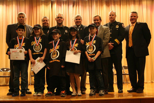 In the photo, front row, the DARE essay winners from each of the five graduating Lewiston-Porter classes.  In the back row, Lewiston Town Councilman Ronald Winkley, Penzotti and Stafford, Lewiston Town Supervisor Steve Reiter, Lewiston Town Councilman Mike Marra, Salada and Lewiston Porter IEC Principal Andrew Auer.