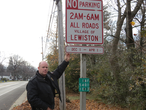 Lewiston Police Chief Chris Salada stands next to the `No parking` sign on North Second Street.