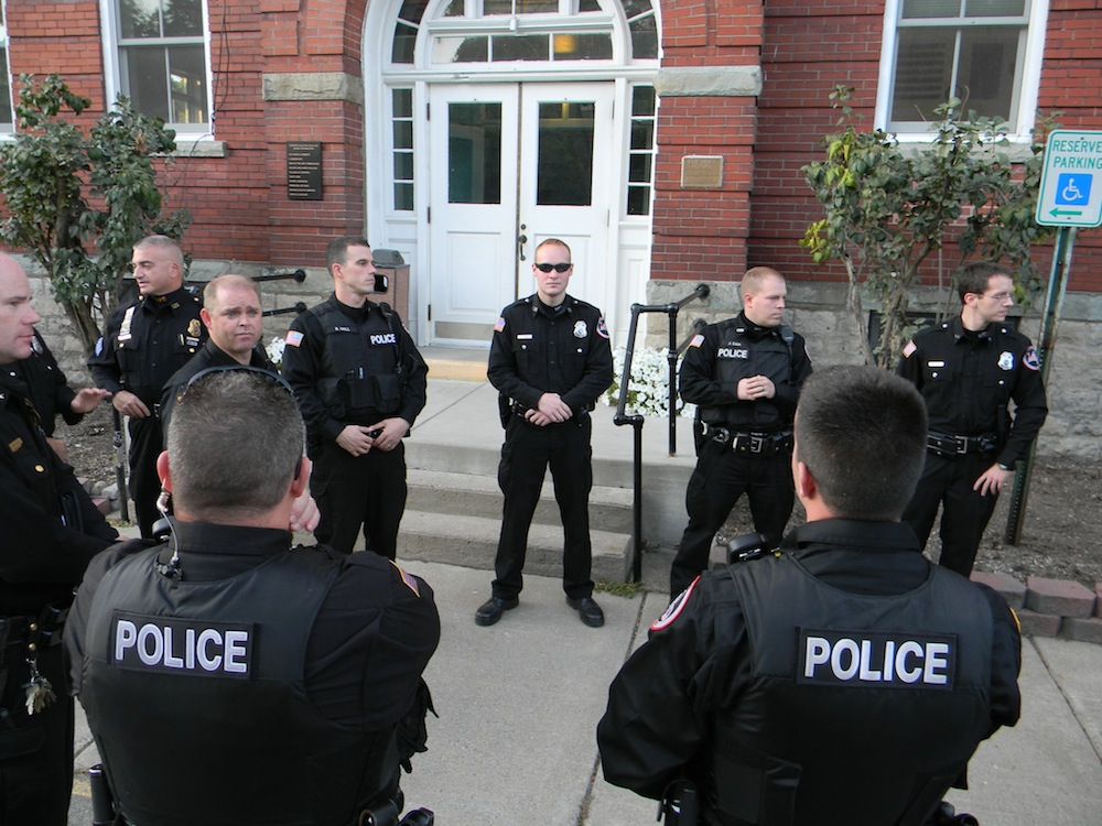 Chief Chris Salada and Lewiston Police Department officers gather outside the Red Brick Municipal Building Thursday.