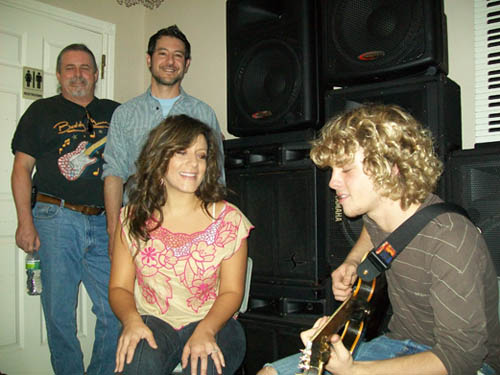 Tony Petrocelli (second from left) and guitar teacher Jack Thurman (far left) watch as vocal coach Melissa Barry works with guitarist Steve Fleck.