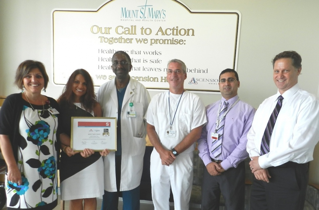 Showing the award, from left, Rosanne Schiavi; Jennifer Kieta; Dr. Lloyd Brown, medical director for emergency services; William Paul, director of emergency services; Baljinder Singh; and Gregory Sambuchi, head of the stroke care program at Mount St. Mary's.