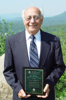 Nino Montani with the Hall of Fame Award he received from Credit Union Association of New York.