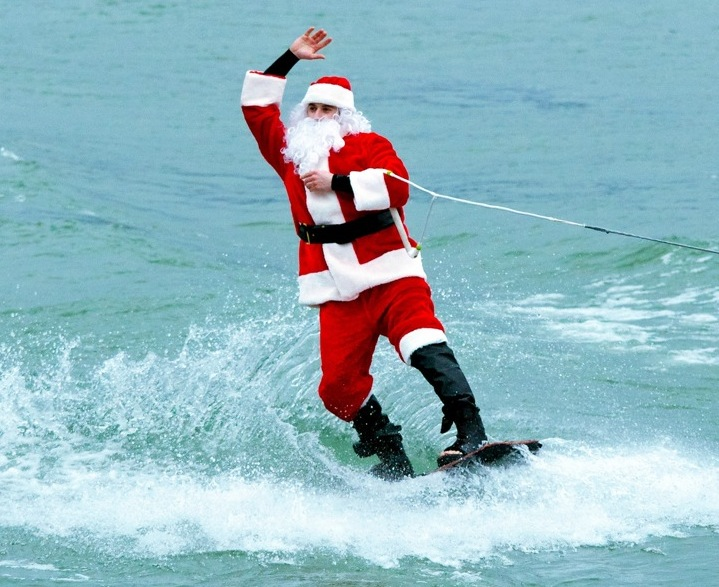 Derek Doll, of Tonawanda, dressed as Santa Claus, waves to the crowd on the Lewiston sand docks.