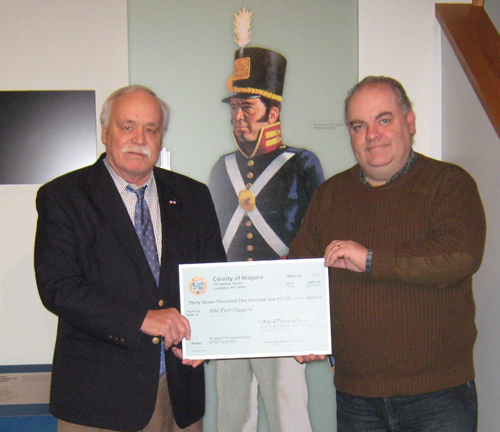 Niagara County Legislator Clyde Burmaster presents a check to Robert Emerson, executive director of Old Fort Niagara.