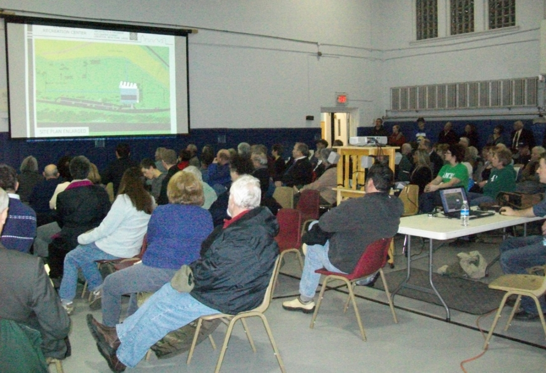 Residents watch as architect David Giusiana explains plans to build the recreation center on the Lewiston plateau.