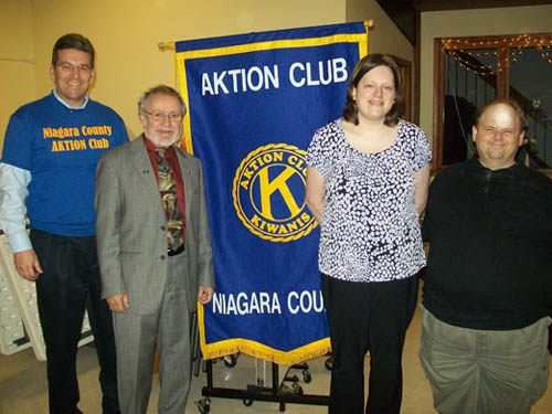 Rivershore Executive Director Jeff Sanderson and Kiwanis Club President Jerry Mosey (left) pose with members of the Aktion Club. (photo by Joshua Maloni)
