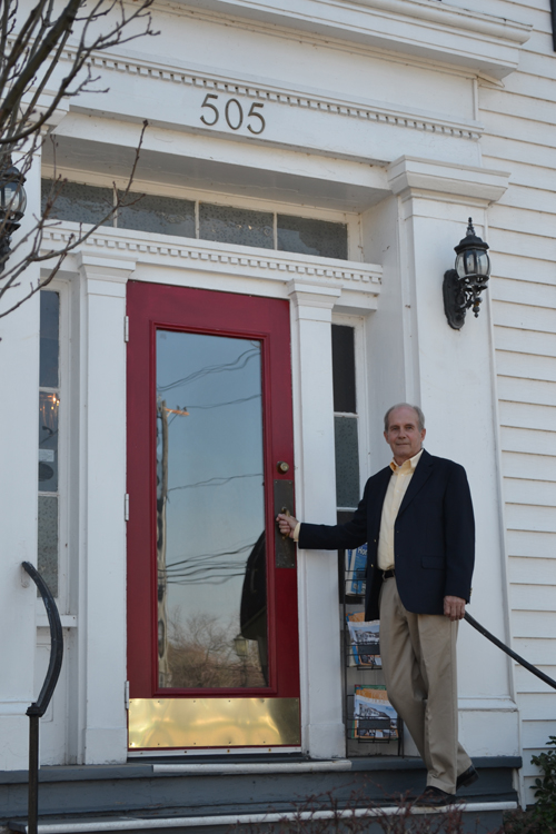 Robert Welch, shown outside of what was once his maternal great-great grandfather's home on Center Street.