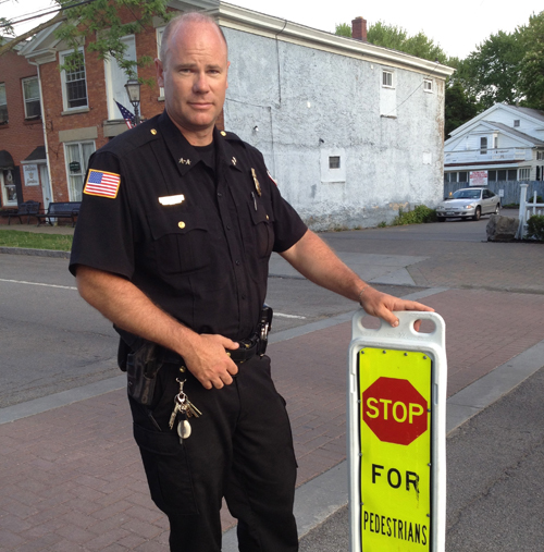 Lewiston Police Department Chief Chris Salada reminds drivers to yield to pedestrians at posted crosswalks such as the one in front of Apple Granny Restaurant.