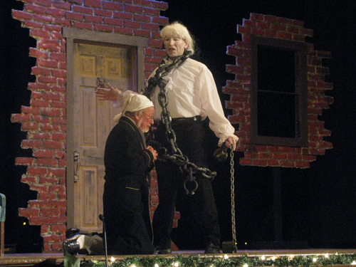 Jerry Mosey as Scrooge meets his first visitor, Marley's Ghost, played by Jack Agugliaro.