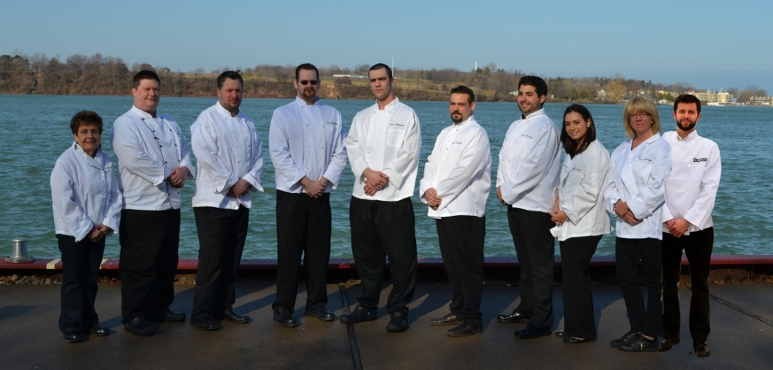 Local chefs `step up to the plate` for the annual Tour of Kitchens. Pictured from left: Anne Macri (Macri's Italian Grille), Tom McCormick (Town Hall American Bistro), Jeremey Lyautey (Wegmans - Niagara Falls), Richard Schwertfager (DiCamillo Bakery), Casey Lort (Water Street Landing), Mike Attardo (The Red Coach Inn and the Bistro at the Old Fort Inn), Michael and Lindsay Fiore (The Village Bake Shoppe), Cathy Pasquantino (The Youngstown Village Diner) and Christian Willmott (The Nine's Catering Company).