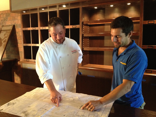Town Hall owner and chef Tom McCormick (left) goes over some blueprints with Josh Palermo of Jay Electric.