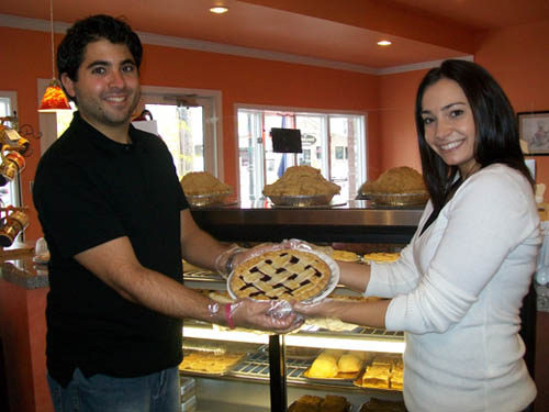 Michael and Lindsay Fiore pose with one of the from-scratch pies at the Village Bake Shoppe in Lewiston.