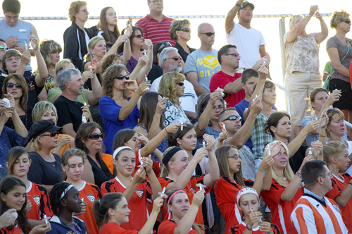 The Wilson and Ransomville area community came out in force Tuesday evening to show its support for the Johnson family, filling the grandstand at Wilson High School's Walter J. Hutchison Field (above). Messages of faith from local ministers, candles and the warmth of friends were exhibited to help the community and family deal with the loss of Sarah, and all the Johnson family is going through. (photo by Wayne Peters)