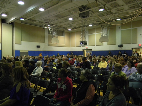 Residents crowd the gym at Stevenson Elementary in Ransomville Tuesday to protest a closing of the school eyed by the Wilson Central School District.