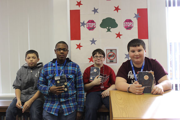 From left are Devyn Munoz (Niagara-Wheatfield), Jaylan McWilson (Niagara Falls), Aidin Reed (Wilson) and Kyle Howes (Niagara-Wheatfield) with the book that inspired them, `The Misfits.`