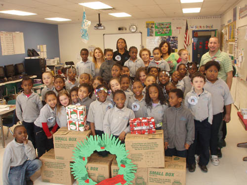 Shown are the second-grade classes at Niagara Charter School, and Sara and Wanasia singing, `All I Want for Christmas is My Two Front Teeth.`