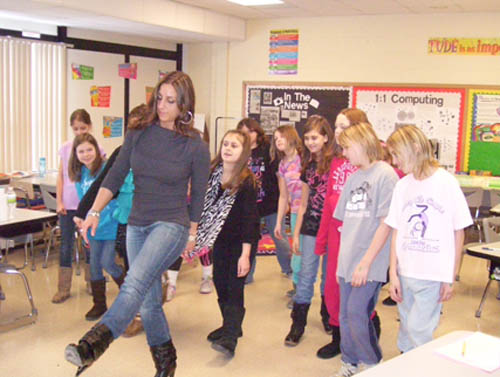 Tricia Manarino teaches students dance moves during Career Day at Colonial Village Elementary School.