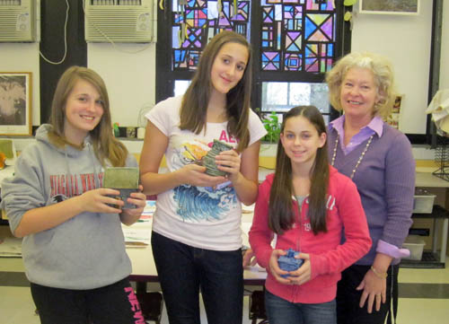 Shown from left are Edward Town art students Sam Tycz, Lauren Sherman and Marissa Guilani, with teacher Jill Hessinger.