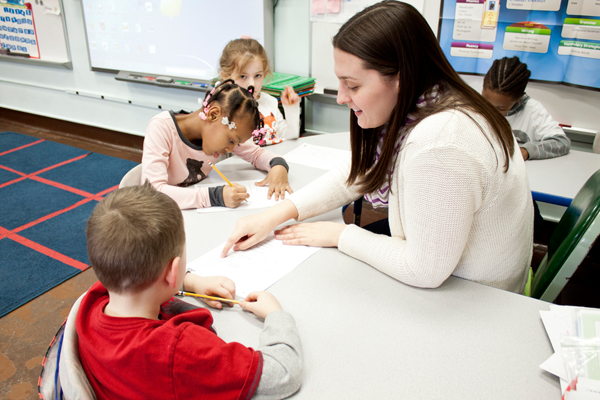 Niagara University student-teacher Emma Pullano administers a math test to students in Mrs. Nancy Scirto's first-grade class at Maple Avenue Elementary School in Niagara Falls. Pullano will teach in Holyoke, Massachusetts, next year through the Teach For America program.