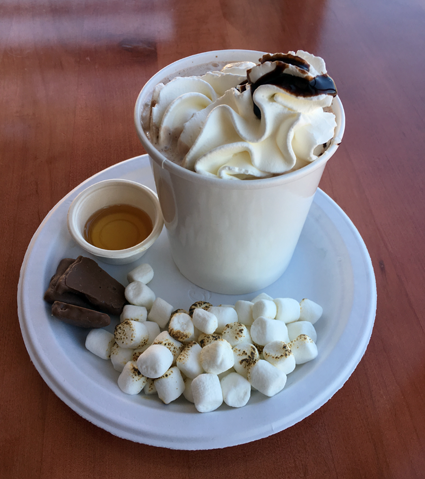 One of Lake Effect's new Warm Front Floats, called Chocolate S'more, features frozen hot chocolate ice cream with hot chocolate, toasted marshmallows, chocolate-covered graham crackers, and a side of syrup.
