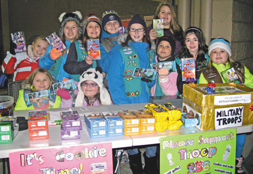 Girl Scouts set up a cookie table outside Sam's Club this week. From left, back row, are Elizabeth Humphrey, Christy Faller, Natalie Clause, Diega Ciraolo, Alexis Fuller and Bianca Gynan; front row, Carly Faller, Jenna Harvey, Cayla Swanson, Izzy Villella and Nikki Faller.