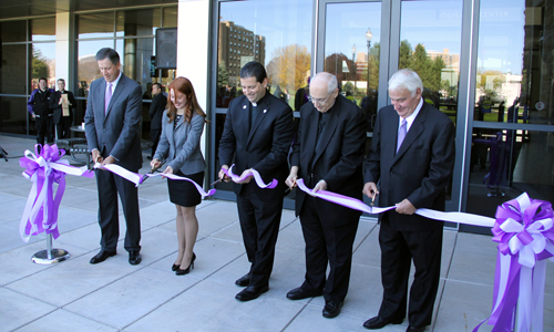 From left: Jeffrey Holzschuh, '82, Bethany Zakrzewski, '14, Father James J. Maher, C.M., Father Joseph L. Levesque, C.M., and Tom Golisano cut the ribbon to signify the official opening of the B. Thomas Golisano Center for Integrated Sciences.