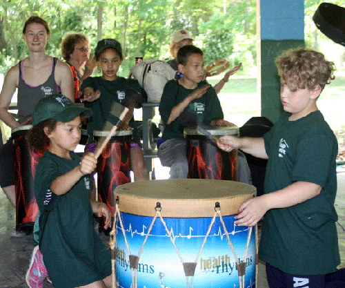 Camp Hope 2016 campers are shown enjoying the drumming circle.