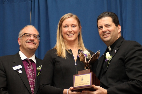 Jessica Kemp, founder of the Kemp Financial Group, receives the 2014 Canadian Business of the Year award from Dr. Shawn Daly, dean of the College of Business Administration, and the Rev. James J. Maher, C.M., president of Niagara University.